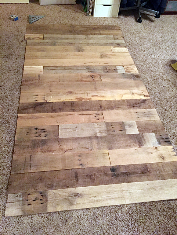 Diy reclaimed wood wall frugal novice for Adhesive reclaimed wood planks